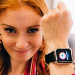 A happy redhead trailing a new Apple Watch