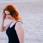 Melbourne Blogger Michelle Radcliffe walks along a beach.