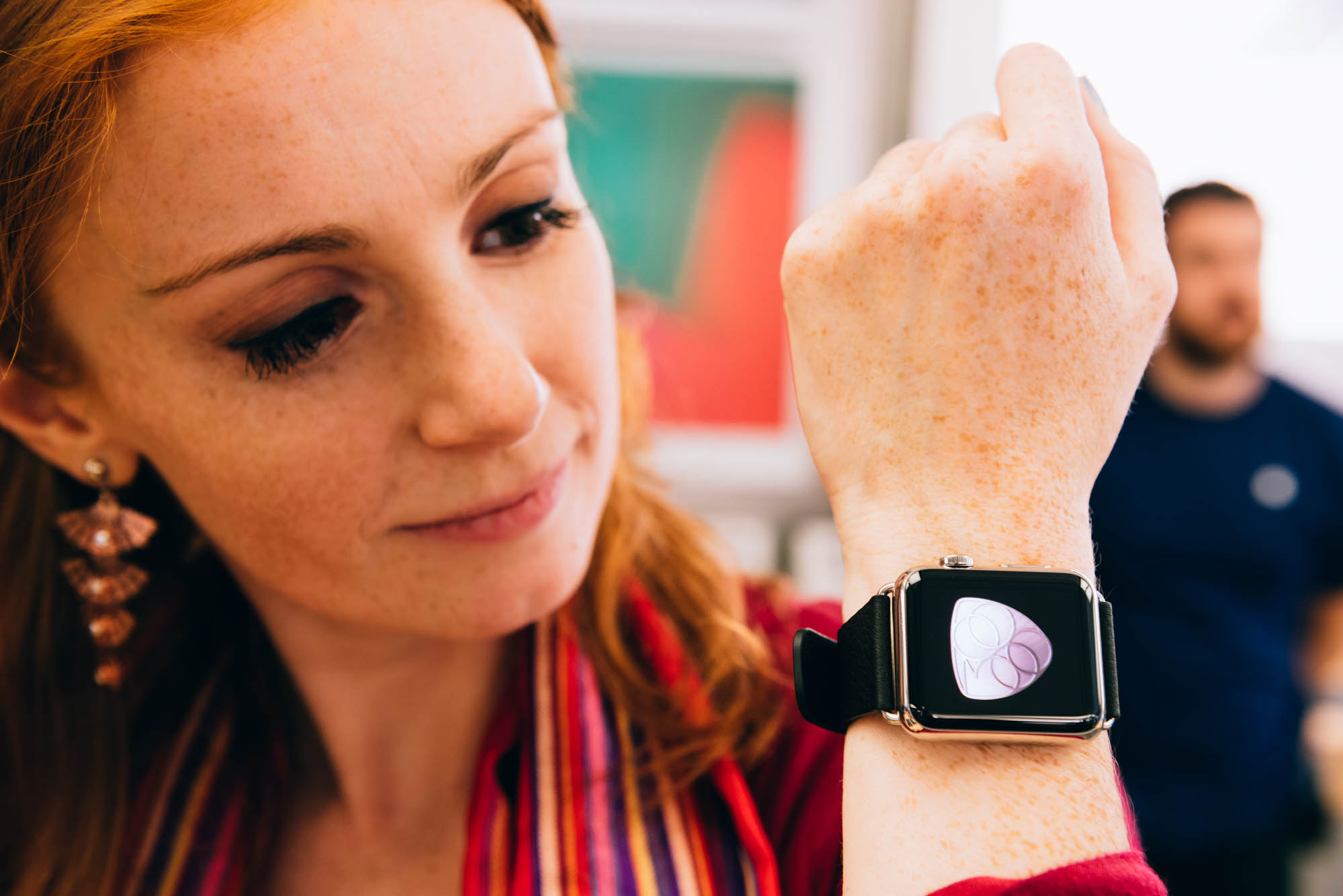 A new Apple Watch on the wrist of a redhead