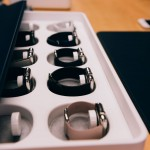 Apple Watches sit in their sizing box