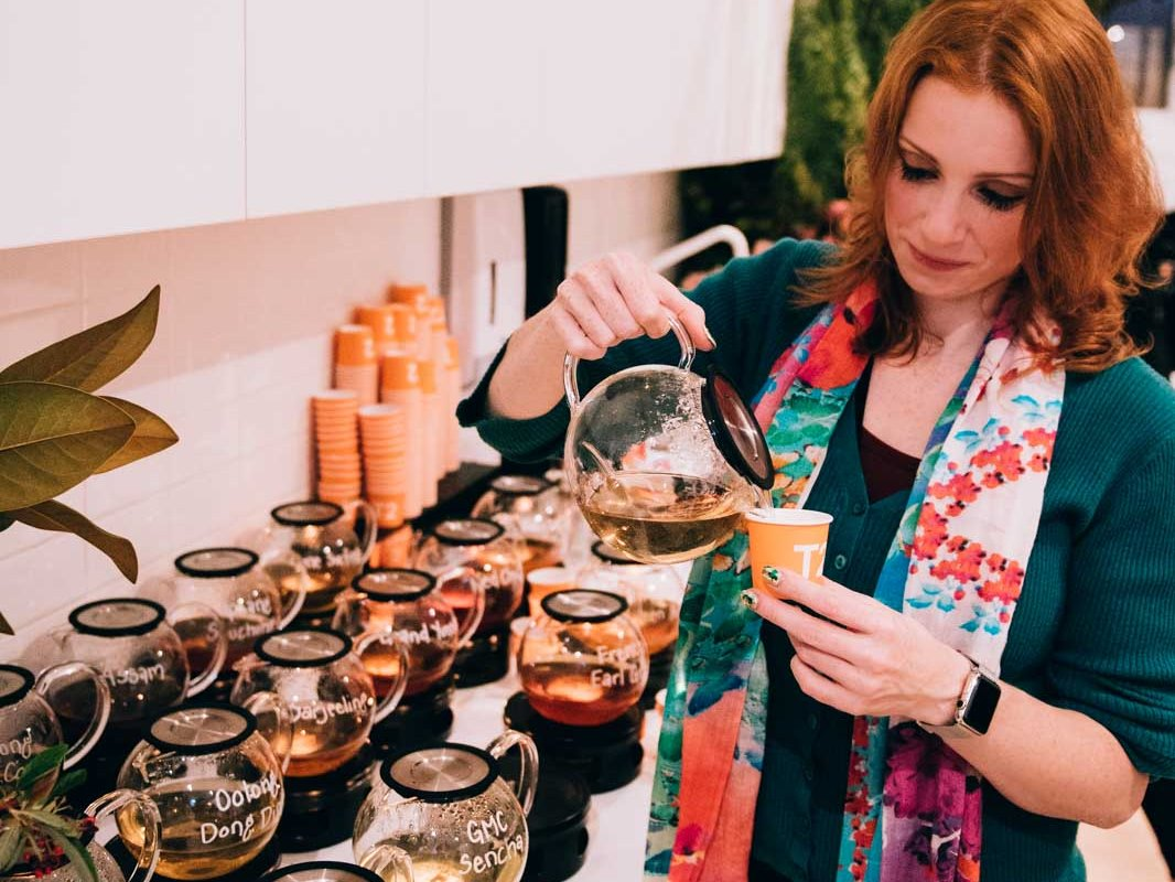 Pouring a cup of T2 tea at the Autumn Edition Tea Workshop
